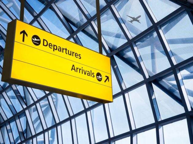 Departures and Arrivals sign at airport
