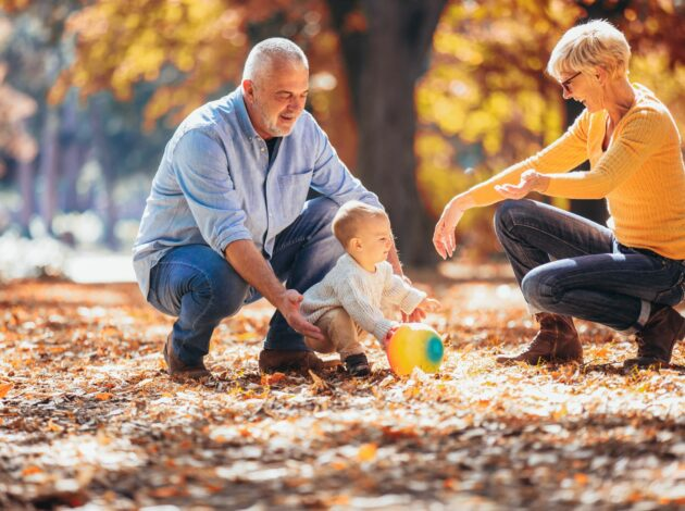 Image of grandparents playing with a baby